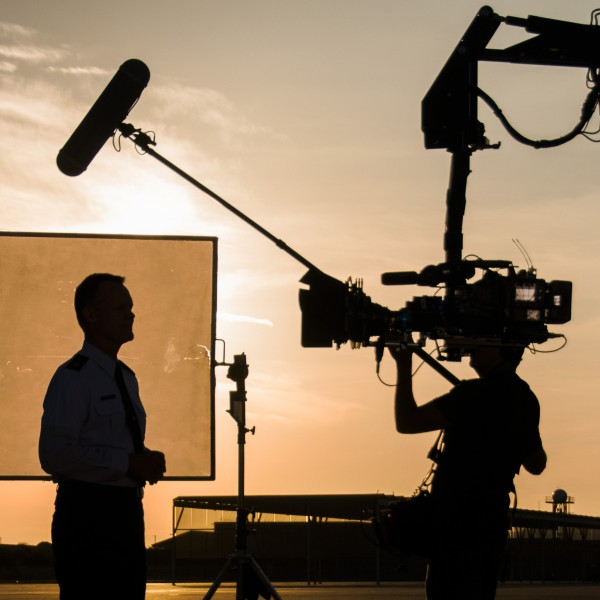 Chaplain Col. William T. Yates, deputy director of the Air National Guard Chaplain Corps, is silhouetted by the rising sun as he recites his lines while being filmed by the Air National Guard Recruiting Creative Marketing team at Davis-Monthan Air Force Base July 16, 2014. The team is filming a chaplain recruiting advertisement for the Air National Guard.